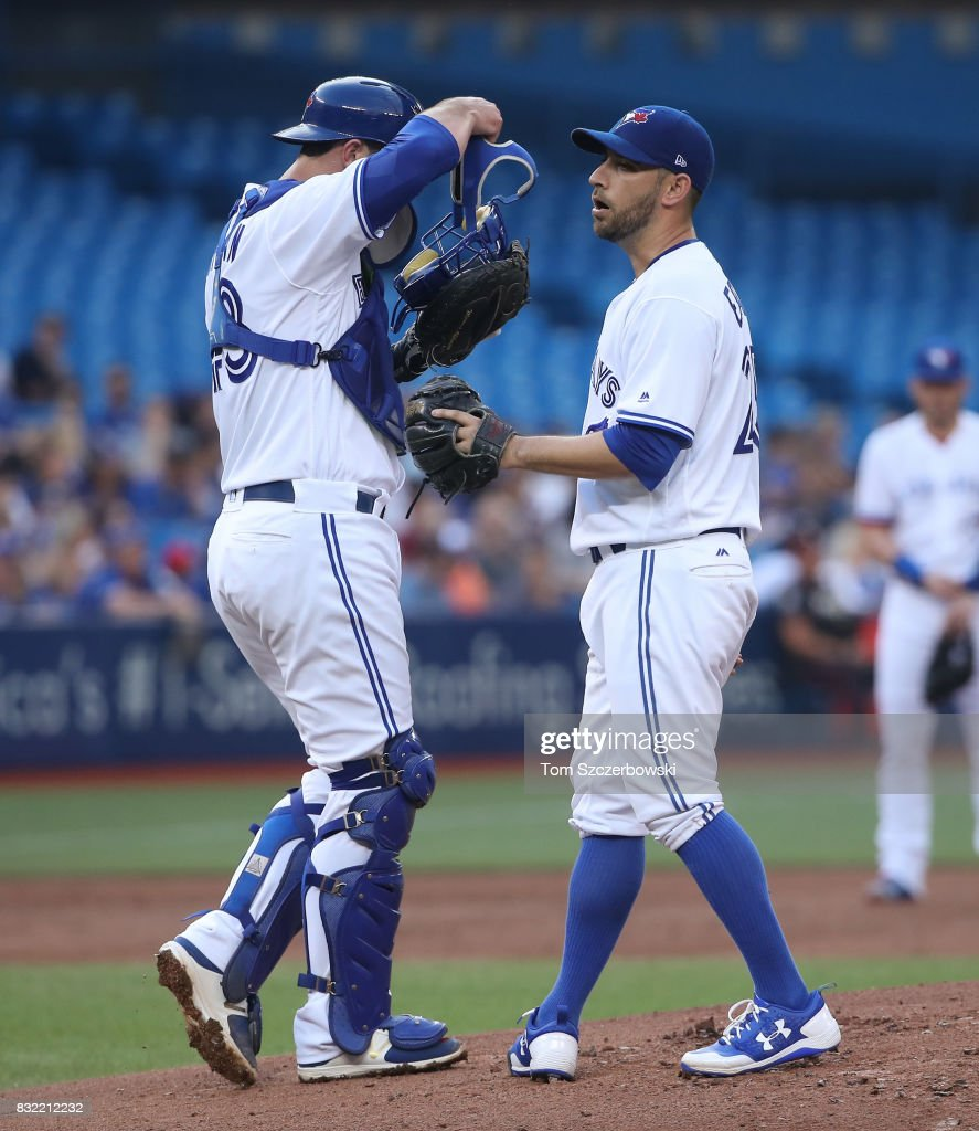 Marco Estrada #25 of the Toronto Blue Jays is visited on the mound by Mike Ohlman #43 in the second inning during MLB game action against the Tampa Bay Rays at Rogers Centre on August 15, 2017 in Toronto, Canada.