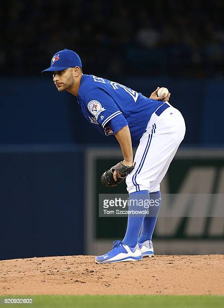 Marco Estrada of the Toronto Blue Jays looks in before delivering a pitch in the second inning during MLB game action against the Boston Red Sox on...