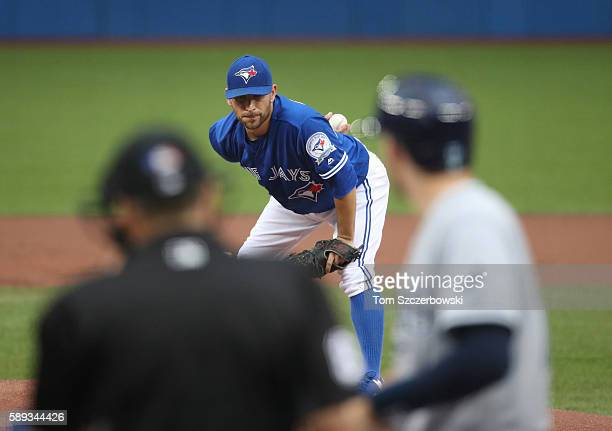 Marco Estrada of the Toronto Blue Jays looks in before delivering a pitch in the first inning during MLB game action against the Tampa Bay Rays on...