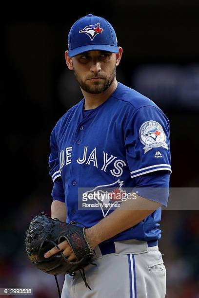 Marco Estrada of the Toronto Blue Jays prepares to throw a pitch against the Texas Rangers during the first inning in game one of the American League...