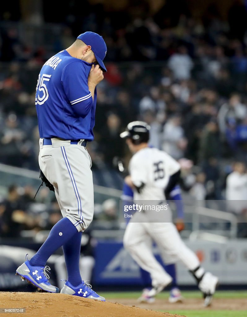 Marco Estrada #25 of the Toronto Blue Jays reacts as Tyler Austin #26 of the New York Yankees rounds third base after he hit a two run home run in the second inning at Yankee Stadium on April 20, 2018 in the Bronx borough of New York City.