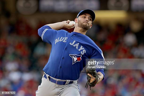 Marco Estrada of the Toronto Blue Jays throws a pitch against the Texas Rangers in game one of the American League Divison Series at Globe Life Park...