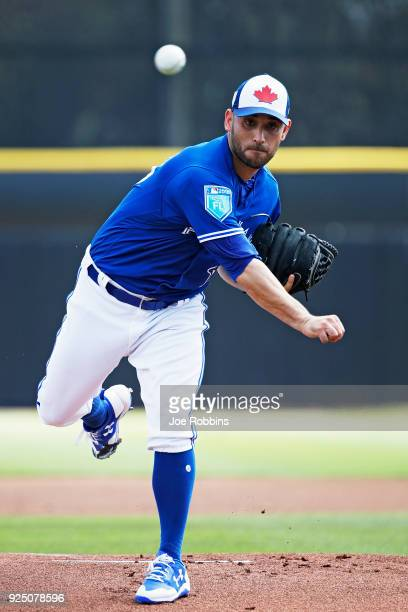 Marco Estrada of the Toronto Blue Jays throws a warm up pitch before the first inning of a Grapefruit League spring training game against the New...