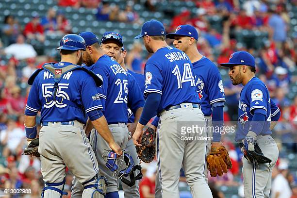 Marco Estrada of the Toronto Blue Jays walks off the mound during the ninth inning against the Texas Rangers in game one of the American League...