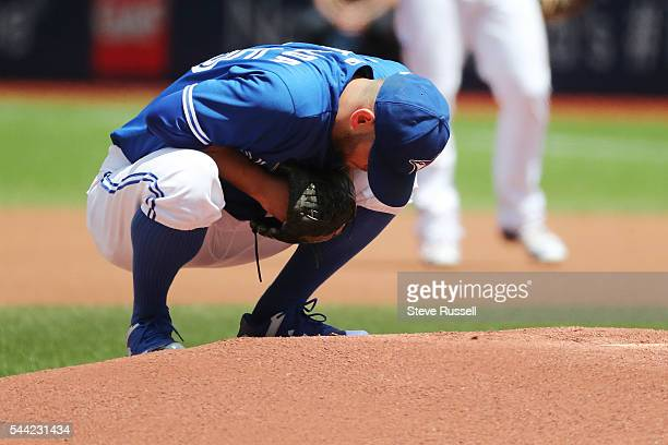 TORONTO ON JULY 2 Marco Estrada stretches out his back early in the game as the Toronto Blue Jays beat the Cleveland Indians 96 to end their 14 game...