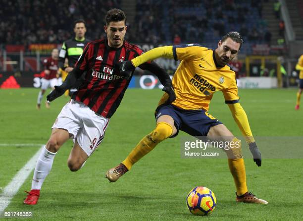 Marco Ezio Fossati of Hellas Verona FC competes for the ball with Andre Silva of AC Milan during the Tim Cup match between AC Milan and Hellas Verona...