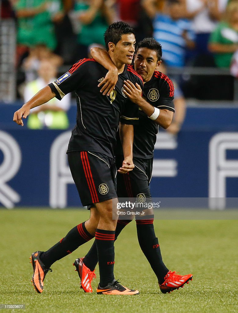 Marco Fabian #10 (R) and Raul Jimenez #9 of Mexico celebrate against Canada at CenturyLink Field on July 11, 2013 in Seattle, Washington. Each scored a goal in the 2-0 defeat of Canada.