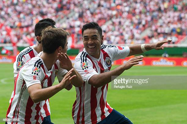 Marco Fabian de la Mora of Chivas celebrates with teammates after scoring the first goal of the game during a match between Chivas and Leon as part...