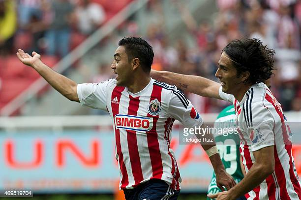 Marco Fabian de la Mora of Chivas celebrates with teammates after scoring the opening goal during a match between Chivas and Leon as part of 13th...