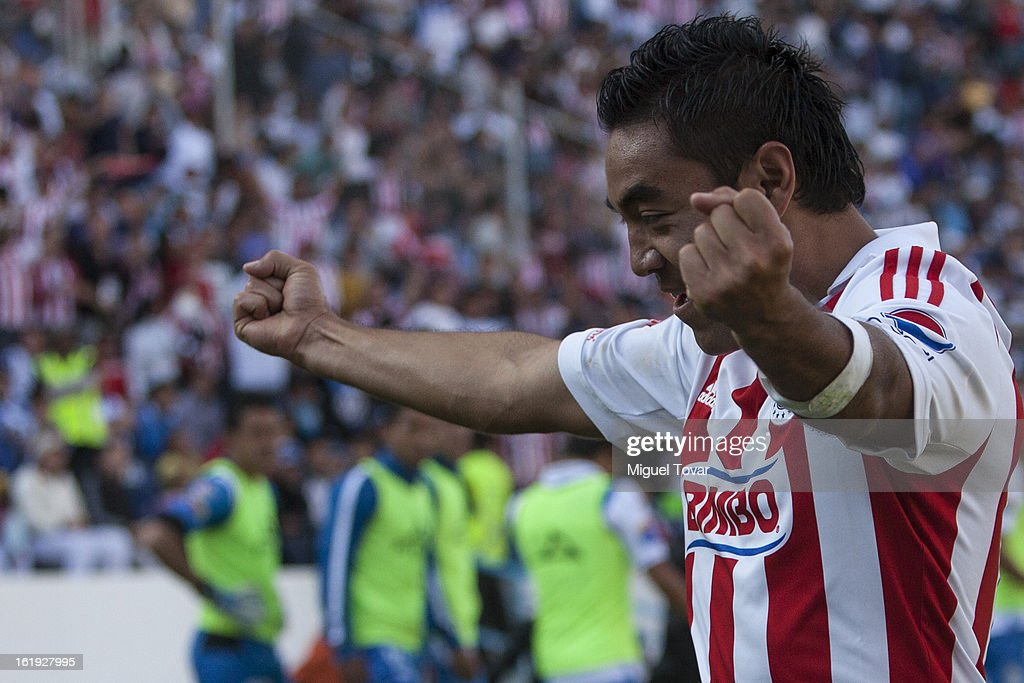 Marco Fabian of Chivas celebrates after scoring during a match between Puebla and Chivas as part of the Clausura 2013 at Cuauhtemoc Stadium on February 17, 2013 in Puebla, Mexico.