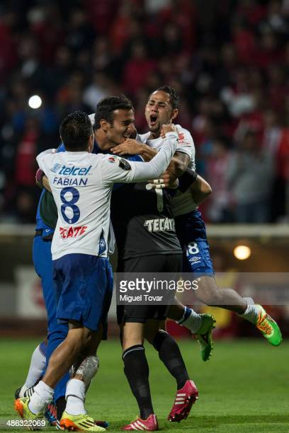 Marco Fabian of Cruz Azul and his teammates celebrate after winning the leg 2 of the final match between Cruz Azul and Toluca as part of the CONCACAF...