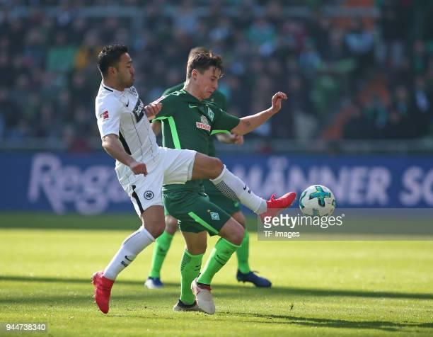 Marco Fabian of Frankfurt and Marco Friedl of Bremen battle for the ball during the Bundesliga match between Werder Bremen and Eintracht Frankfurt at...
