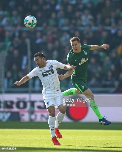 Marco Fabian of Frankfurt and Niklas Moisander of Bremen battle for the ball during the Bundesliga match between Werder Bremen and Eintracht...