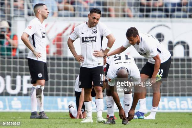 Marco Fabian of Frankfurt and team mates react after the Bundesliga match between Eintracht Frankfurt and Hertha BSC at CommerzbankArena on April 21...