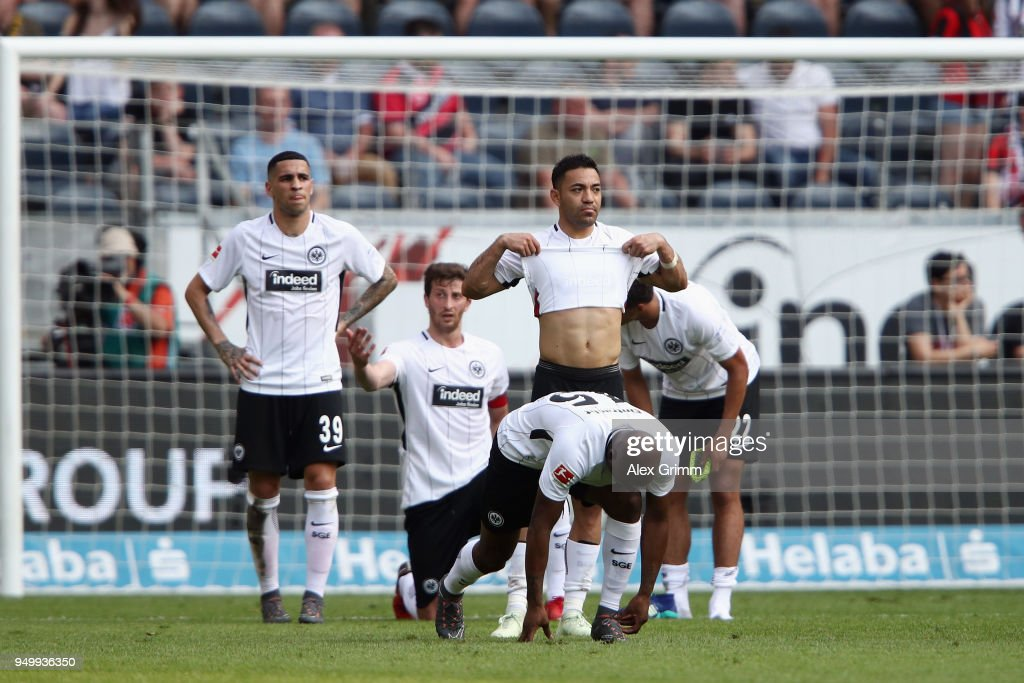 Marco Fabian of Frankfurt and team mates react after the Bundesliga match between Eintracht Frankfurt and Hertha BSC at Commerzbank-Arena on April 21, 2018 in Frankfurt am Main, Germany.