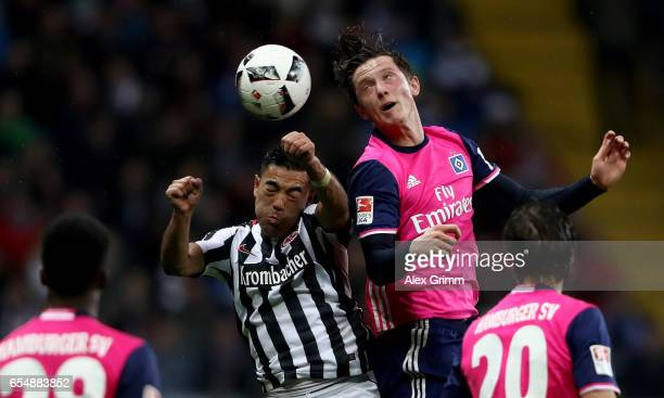 Marco Fabian of Frankfurt goes up for a header with Michel Gregoritsch of Hamburg during the Bundesliga match between Eintracht Frankfurt and...