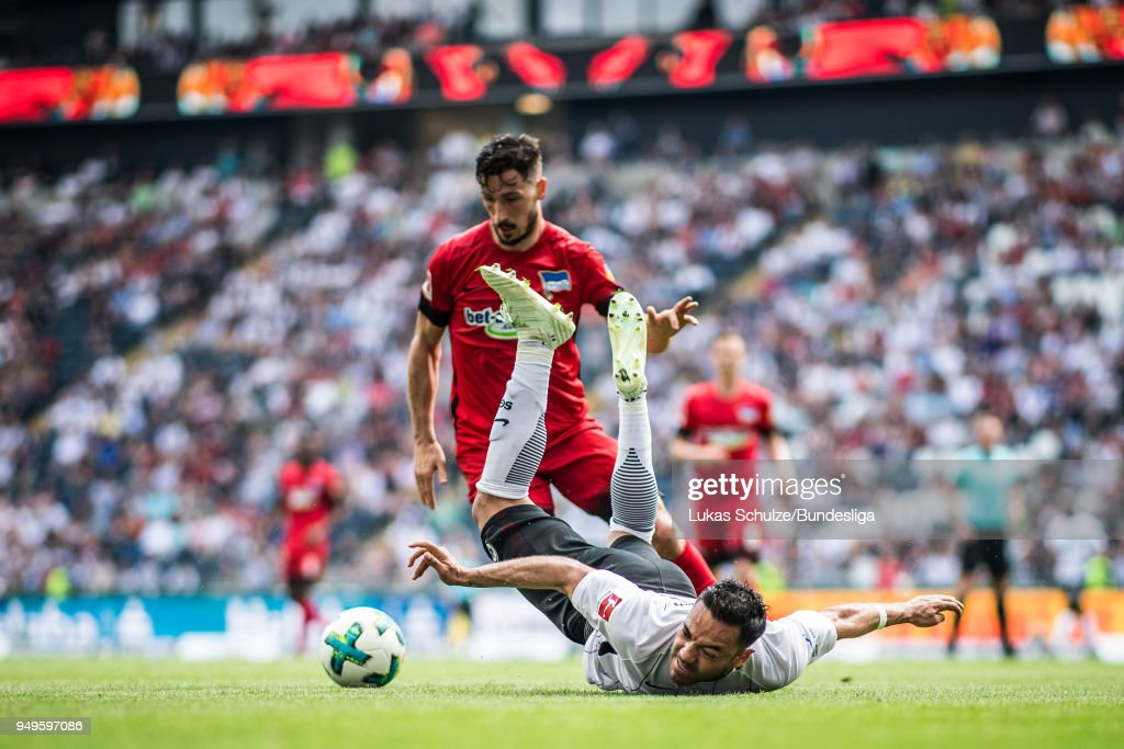 Marco Fabian of Frankfurt is attacked by a player of Berlin during the Bundesliga match between Eintracht Frankfurt and Hertha BSC at Commerzbank-Arena on April 21, 2018 in Frankfurt am Main, Germany.
