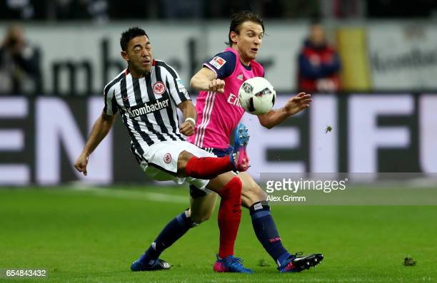 Marco Fabian of Frankfurt is challenged by Albin Ekdal of Hamburg during the Bundesliga match between Eintracht Frankfurt and Hamburger SV at...