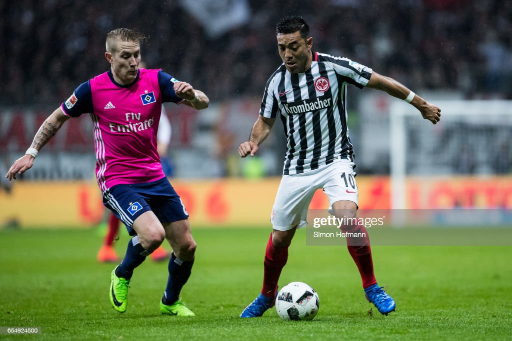 Marco Fabian of Frankfurt is challenged by Lewis Holtby of Hamburg during the Bundesliga match between Eintracht Frankfurt and Hamburger SV at Commerzbank-Arena on March 18, 2017 in Frankfurt am Main, Germany.