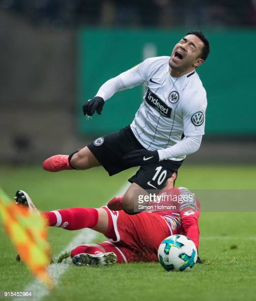 Marco Fabian of Frankfurt is fouled by Danny Latza of Mainz during the DFB Cup quarter final match between Eintracht Frankfurt and 1 FSV Mainz 05 at...