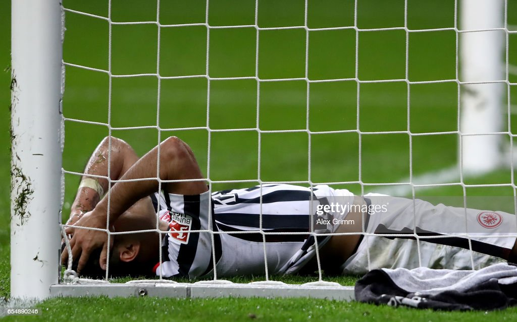 Marco Fabian of Frankfurt lies dejected in the goal during the Bundesliga match between Eintracht Frankfurt and Hamburger SV at Commerzbank-Arena on March 18, 2017 in Frankfurt am Main, Germany.