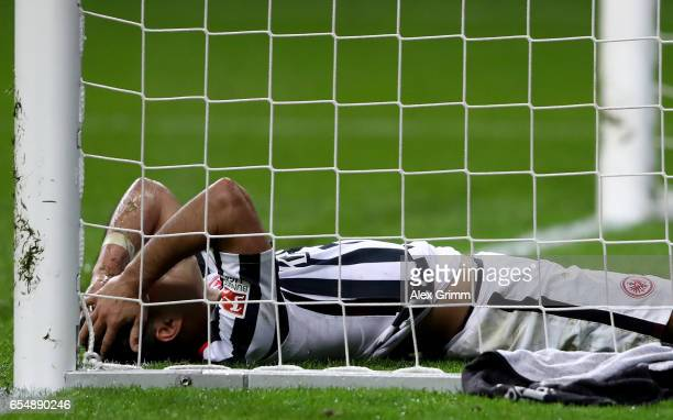 Marco Fabian of Frankfurt lies dejected in the goal during the Bundesliga match between Eintracht Frankfurt and Hamburger SV at CommerzbankArena on...