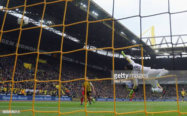 Marco Fabian of Frankfurt scores his team's first goal past goalkeeper Roman Buerki of Dortmund during the Bundesliga match between Borussia Dortmund...