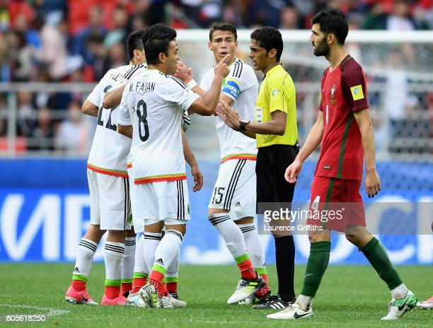 Marco Fabian of Mexico argues with Referee Fahad Al Mirdasi during the FIFA Confederations Cup Russia 2017 PlayOff for Third Place between Portugal...