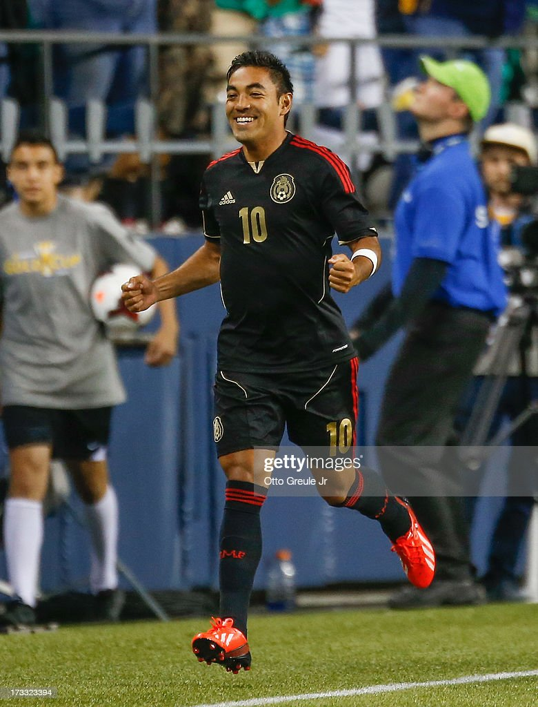Marco Fabian #10 of Mexico celebrates after scoring a goal against Canada at CenturyLink Field on July 11, 2013 in Seattle, Washington. Mexico defeated Canada 2-0.