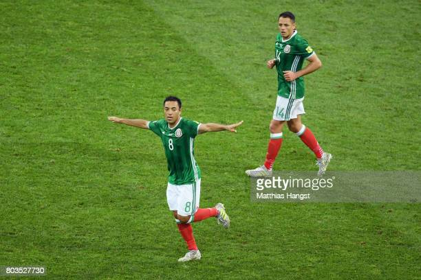 Marco Fabian of Mexico celebrates scoring his sides first goal with Javier Hernandez of Mexico during the FIFA Confederations Cup Russia 2017...