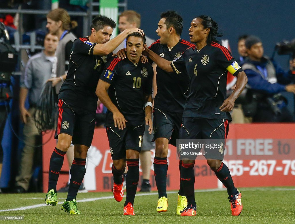 Marco Fabian #10 of Mexico celebrates with teammates after scoring a goal against Canada at CenturyLink Field on July 11, 2013 in Seattle, Washington. Mexico defeated Canada 2-0.