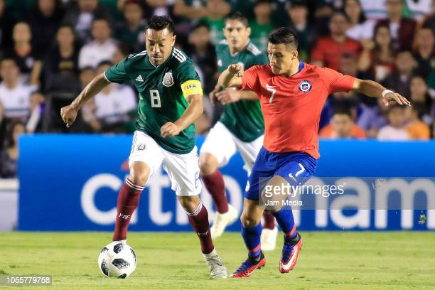 Marco Fabian of Mexico fights for the ball with Alexis Sanchez of Chile during the international friendly match between Mexico and Chile at La...