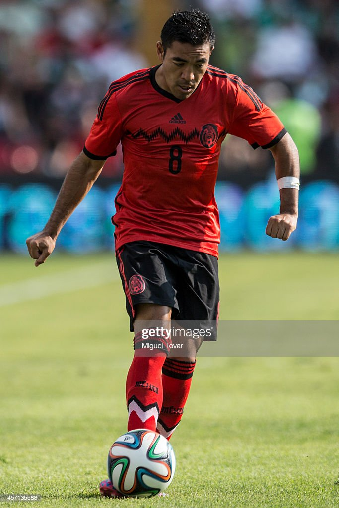 Marco Fabian of Mexico kicks the ball during a friendly match between Mexico and Panama at Corregidora Stadium on October 12, 2014 in Queretaro, Mexico.
