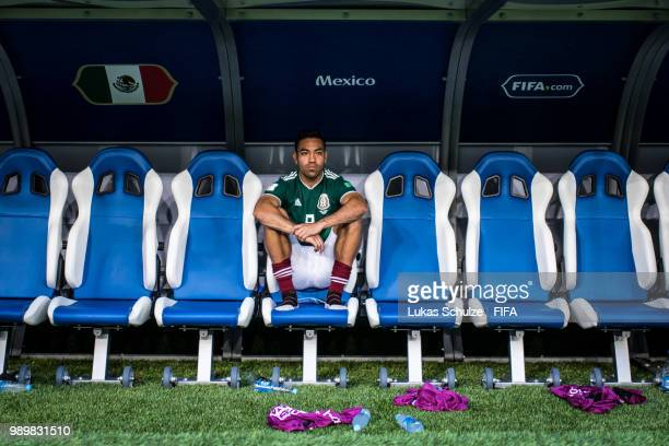 Marco Fabian of Mexico sits on the bench after loosing the 2018 FIFA World Cup Russia Round of 16 match between Brazil and Mexico at Samara Arena on...