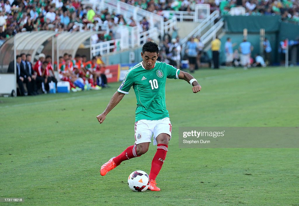 Marco Fabian #10 of Mexico takes a free kick against Panama during the first round of the 2013 CONCACAF Gold Cup at the Rose Bowl on July 7, 2013 in Pasadena, California. Panama won 2-1.