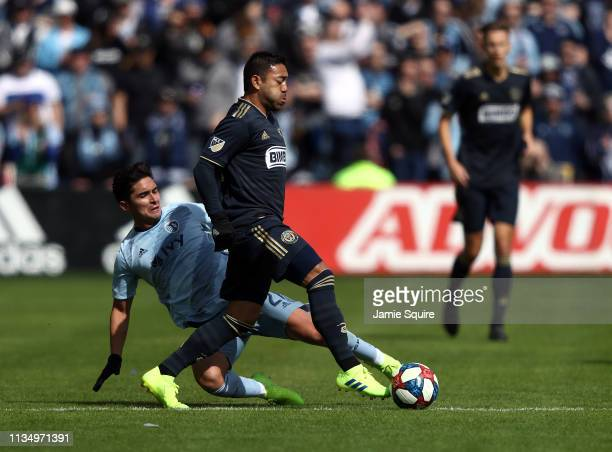 Marco Fabian of Philadelphia Union controls the ball as Felipe Gutierrez of Sporting Kansas City defends during the game at Children's Mercy Park on...