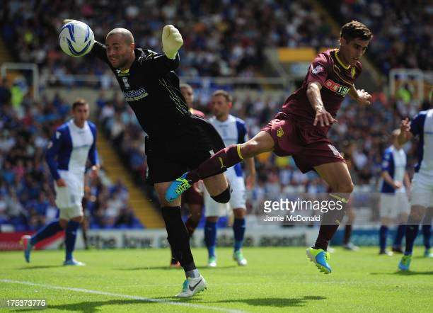 Marco Faraoni of Watford battles with Darren Randolph of Birmingham City during the Sky Bet Championship match between Birmingham City and Watford at...