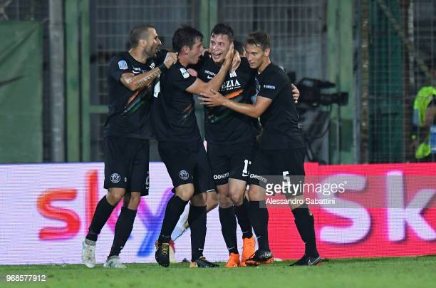 Marco Firenze of Venezia FC celebrates after scoring the 1-1 goal with team mates during the serie B playoff match between Venezia FC and US Citta di...