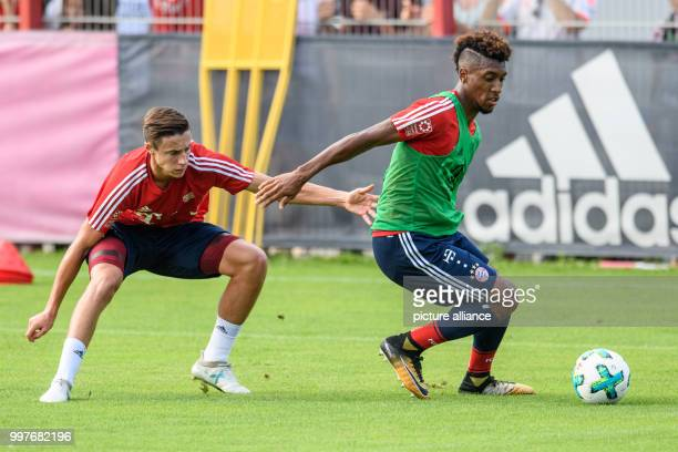 Marco Friedl and Kingsley Coman vie for the ball during a training session at the club's training ground on Saebener Strasse in Munich Germany 30...