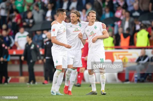 Marco Friedl Michael Lang and Christian Gross of Werder Bremen after the german soccer league match between FC Union Berlin against SV Werder Bremen...