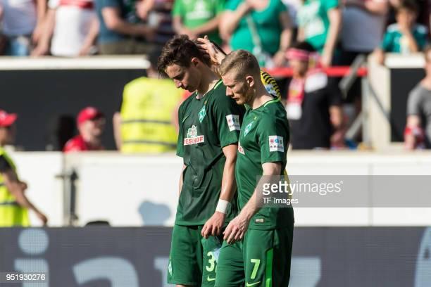 Marco Friedl of Bremen and Florian Kainz of Bremen looks dejected after the Bundesliga match between VfB Stuttgart and SV Werder Bremen at...
