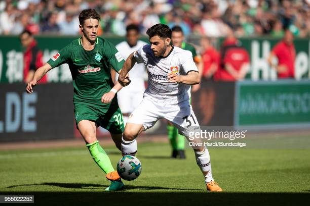 Marco Friedl of Bremen and Kevin Volland of Leverkusen compete for the ball during the Bundesliga match between SV Werder Bremen and Bayer 04...