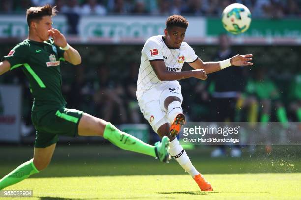 Marco Friedl of Bremen and Leon Bailey of Leverkusen compete for the ball during the Bundesliga match between SV Werder Bremen and Bayer 04...