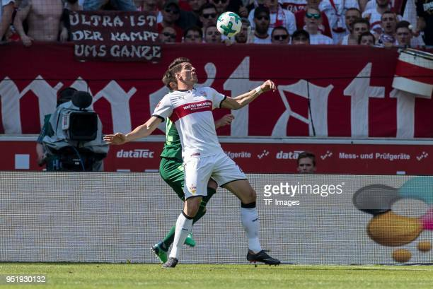 Marco Friedl of Bremen and Mario Gomez Garcia of Stuttgart battle for the ball during the Bundesliga match between VfB Stuttgart and SV Werder Bremen...