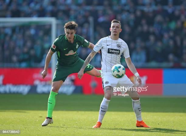 Marco Friedl of Bremen and Marius Wolf of Frankfurt battle for the ball during the Bundesliga match between Werder Bremen and Eintracht Frankfurt at...