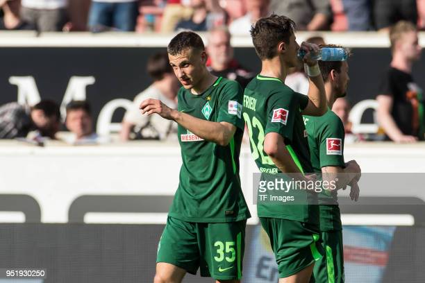 Marco Friedl of Bremen and Maximilian Eggestein of Bremen looks dejected after the Bundesliga match between VfB Stuttgart and SV Werder Bremen at...