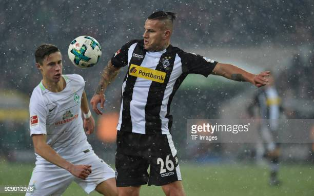 Marco Friedl of Bremen and Raul Bobadilla of Moenchengladbach battle for the ball during the Bundesliga match between Borussia Moenchengladbach and...