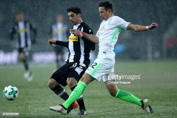 Marco Friedl of Bremen challenges Lars Stindl of Moenchengladbach during the Bundesliga match between Borussia Moenchengladbach and SV Werder Bremen...