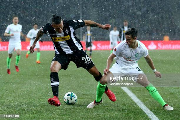 Marco Friedl of Bremen challenges Raul Bobadilla of Moenchengladbach during the Bundesliga match between Borussia Moenchengladbach and SV Werder...