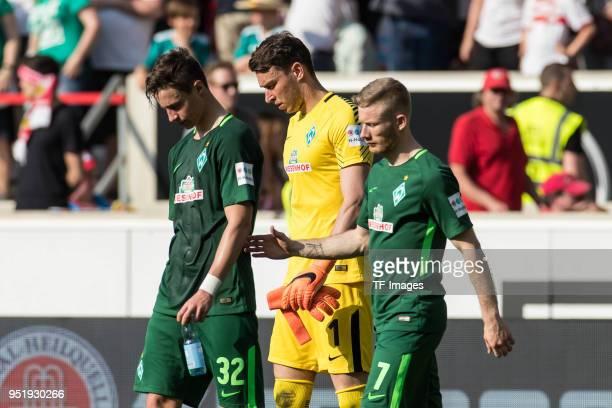 Marco Friedl of Bremen Goalkeeper Jiri Pavlenka of Bremen and Florian Kainz of Bremen look dejected after the Bundesliga match between VfB Stuttgart...